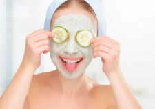51917391 - funny young girl with a mask for skin face and cucumbers on eyes